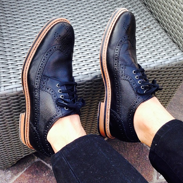 black cole haan wingtips